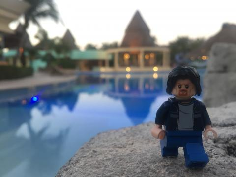 Lego Uncle Jim by the pool at dusk